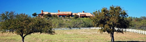 Sorrel Canyon Ranch house on the hill, overlooking the horse pastures below! For Sale!