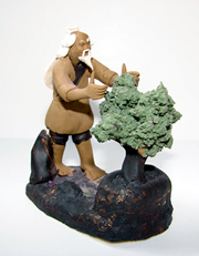 Oriental figurine of man trimming a bonsai tree, small fountain decoration
