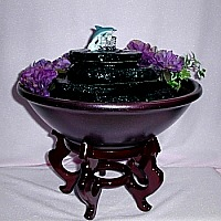 Tabletop fountain with real slate tiers with a dolphin topper